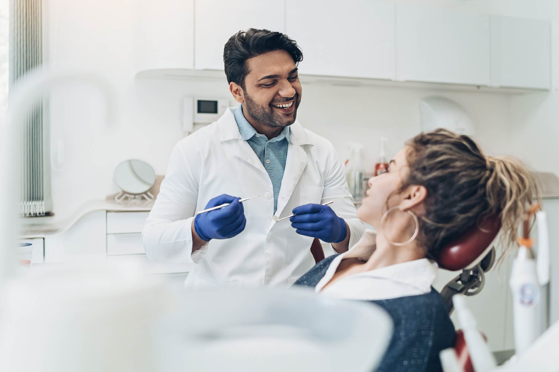 Dentist talking to patient during check-up